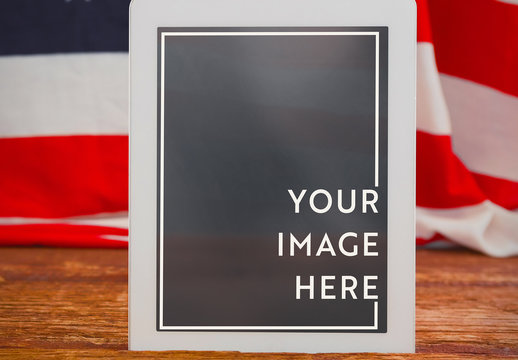 Tablet with American Flag in Background Mockup