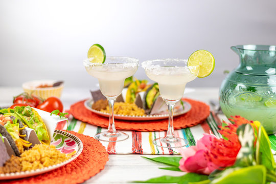 Margaritas with salt and limes and mexican food