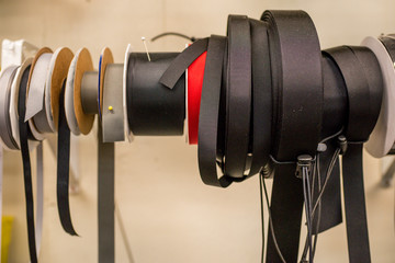 spools of cords nylon straps and fabric ribbon