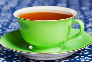 Close up of tea in green china tea cup