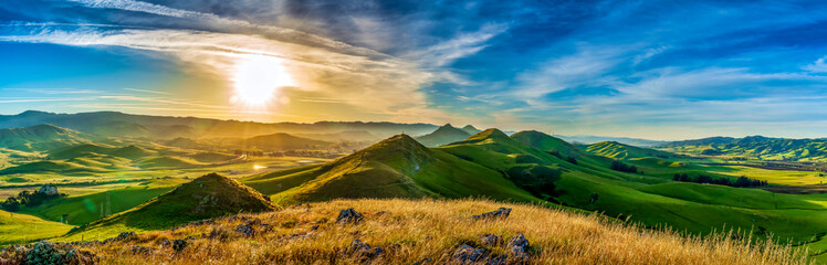 Panorama of Hills of Grass at Sunrise Wall mural