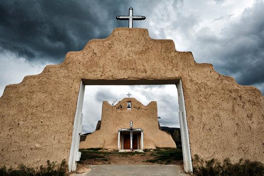 Pueblo church archway under stormy sky, Picuris Pueblo, New Mexico, United States