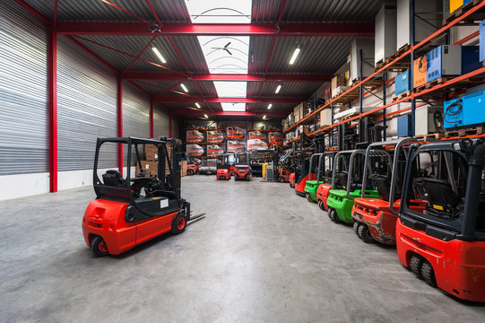 Forklift machinery working in warehouse