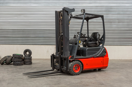 Forklift machinery parked in warehouse