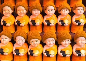 Close up of Buddhist monk dolls