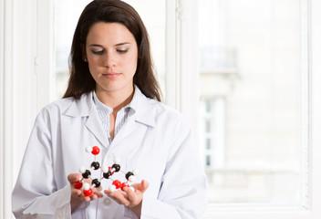 Caucasian scientist examining molecular model