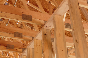 Low angle view of ceiling beams in new house