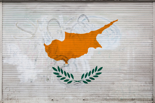 Close-up of old metal wall with national flag of Cyprus. Concept of Cyprus export-import, storage of goods and national delivery of goods. Flag in grunge style