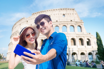 couple selfie happily in Italy Wall mural