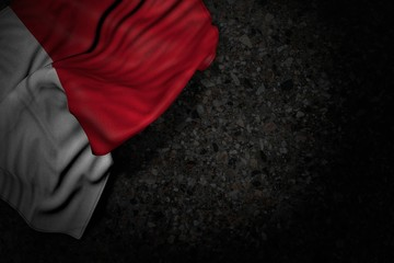 beautiful dark picture of Malta flag with large folds on dark asphalt with free space for text - any feast flag 3d illustration..