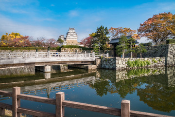 Autumn reflections in water at Sakuramon-bashi bridge over the inner moat at the entry gate to Himeji Castle in Japan.