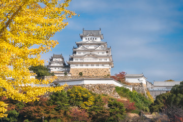 Himeji Castle is a Japanese castle, shown here in autumn, is also called the White Egret or White Heron Castle because of its brilliant white exterior and supposed resemblance to a bird taking flight.