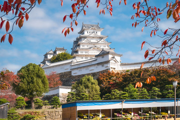 Himeji Castle during Autumn Festival in Japan. Himeji Castle, also called White Heron or White Egret Castle due to its white outer walls, is the best preserved castle in all of Japan