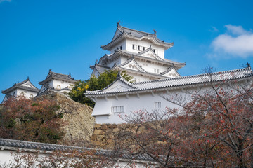 Himeji Castle is the most spectacular castle in all of Japan. The castle, shown here in autumn is also known as White Egret or White Heron Castle due to its pristine white exterior architecture.