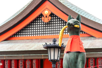 Fox statue of god at Fushimi Inari Taisha Shrine in Kyoto, Japan