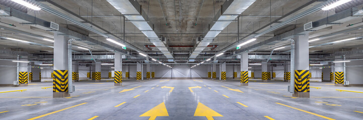 Empty shopping mall underground parking lot or garage interior with concrete stripe painted columns Fototapete