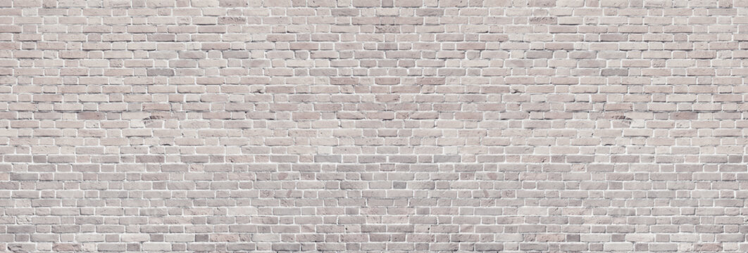 Wide light brick wall texture. Rough brickwork panoramic vintage background