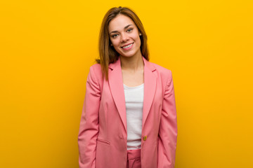 Young fashion business woman happy, smiling and cheerful. Wall mural