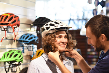 Bicycle shop consulting - customer tests a bicycle helmet for road safety