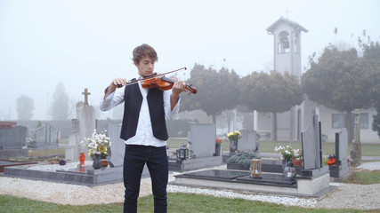 Playing violin on funeral Wall mural
