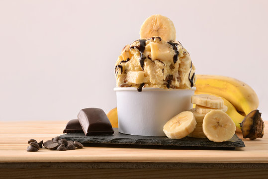 Banana ice cream cup decorated with chocolate