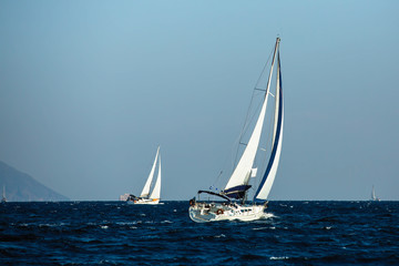 Wall Mural - Sailing yacht boats regatta at the Aegean Sea.