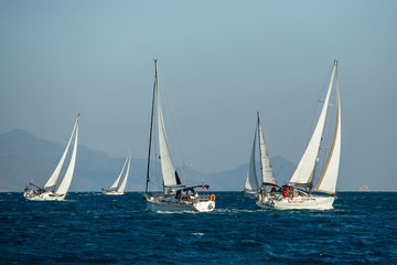 Fototapete - Sailing yacht boats regatta at the Aegean Sea, Greece islands.