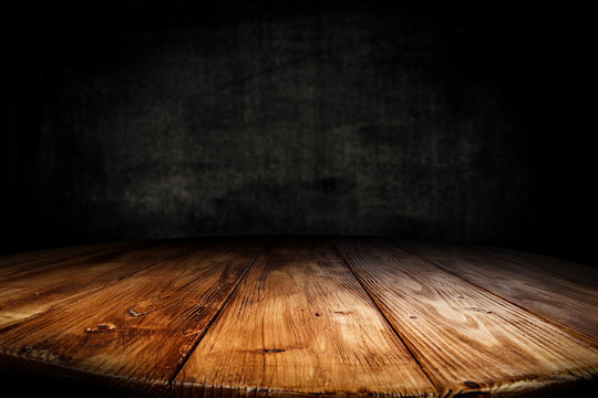 Dark desk background of free space for your decoration and black wall space