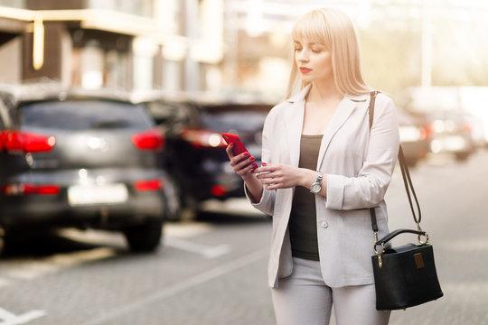 Girl hands using mobile smart phone.