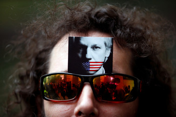 A demonstrator wears a picture of Julian Assange on his sunglasses outside of Westminster Magistrates Court, where Wikileaks founder Julian Assange had a U.S. extradition request hearing, in London