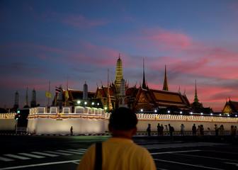 Lights illuminate the Grand Palace during sunset, ahead of King Maha Vajiralongkorn's coronation, in Bangkok