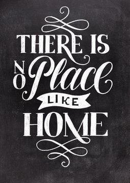 There is no place like home hand drawn lettering on black chalkboard background. Vintage type illustration.