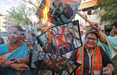 Supporters of India's ruling Bharatiya Janata Party (BJP) burn pictures of Masood Azhar, the head of Pakistan-based militant group Jaish-e-Mohammad, as they celebrate the U.N. Security Council committee's decision to blacklist Azhar, in Ahmedabad