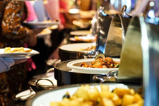 Hand of people take buffet food in hotel party