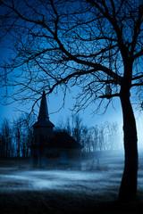 Fototapete - Old chapel on haunted creepy graveyard at night
