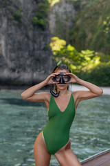Young beautiful girl diver with a mask and snorkel for scuba diving