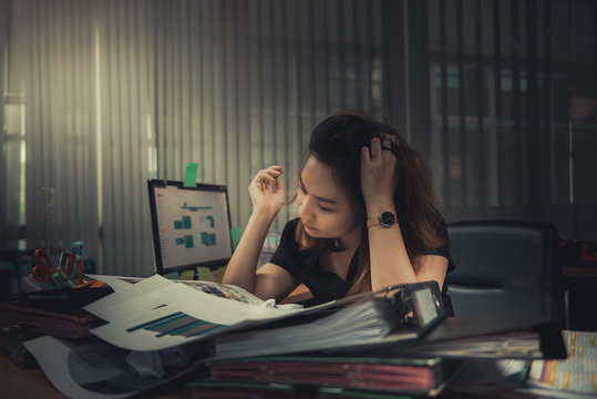 Asian office woman stress from work overload,She stressed because must send work At the specified time,Thailand people,Young secretary tired from boss about new project