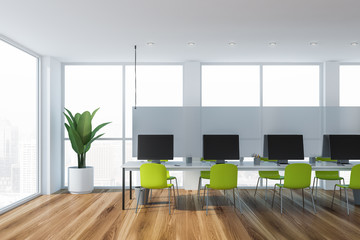 Open space office interior with green chairs