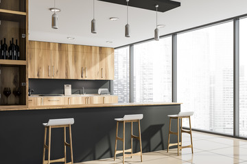 Corner of loft gray kitchen with bar