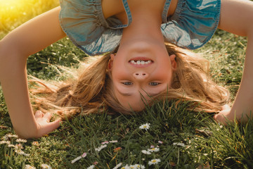 happy child on green gras meadow