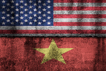 two flags on a cracked wall, USA and Vietnam