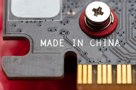 made in china inscription at hardware circuit board. china electronic industry.
