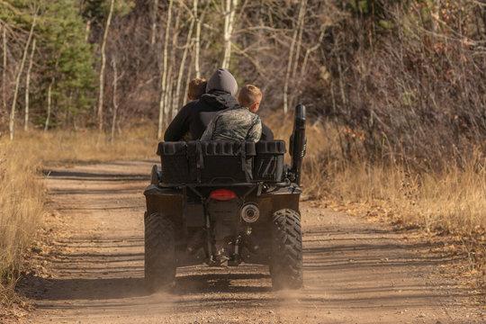 Family riding 4 wheeler
