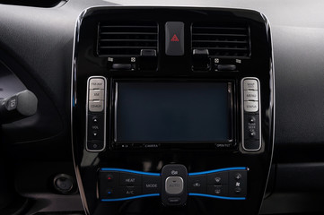 Modern car dashboard with screen multimedia. Interior detail.