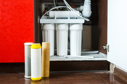 It's time to change water filters at home.  Replace filters in water purifying system. Close up view  of three used filters. Clean water at home