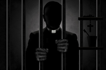 A Catholic priest identified by his clergyman collar is seen in silhouette behind bars with his filthy hands gripping the bars. He is in shadows and his face is in darkness.