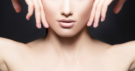 Lips, hands, neck. Partial view of beauty young woman face with perfect skin