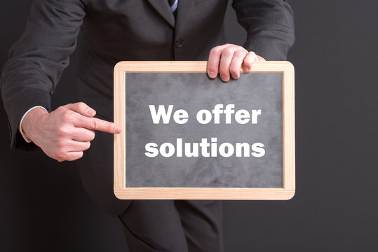 Sign We offer solutions with a businessman