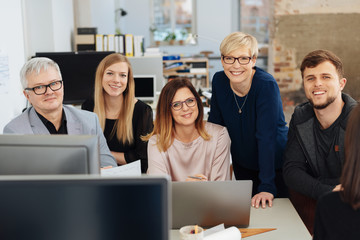 Happy successful business team posing in an office
