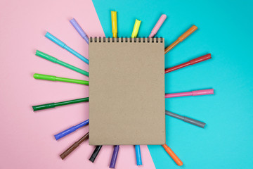 School notebook and various stationery. Back to school concept. Multicolored background.